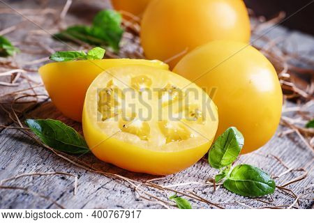 Large Yellow Tomatoes With Basil, Vintage Wooden Background, Selective Focus
