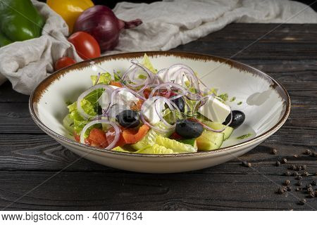 Vegetable Salad With Feta Cheese. Lettuce, Olives, Red Bell Peppers, Cherry Tomatoes, Onion Rings, C
