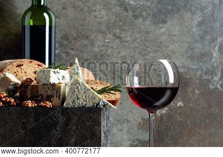 Blue Cheese And Red Wine. Cheese With Walnuts, Bread, And Rosemary. Copy Space.