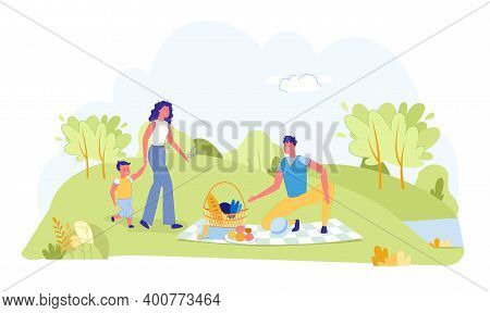 Happy Family Enjoying Picnic On Summer Vacation. Summertime And Outdoors Recreation. Father, Mother,