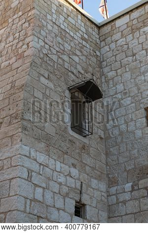 Bethlehem, Israel, December 09, 2020 : Window With Bars On The Wall Of The Church Of Nativity Buildi
