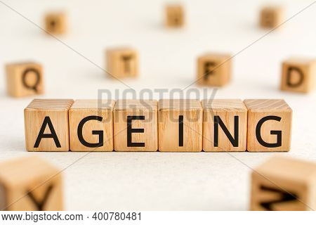 Ageing - Word From Wooden Blocks With Letters, Growing Old Senescence Ageing Concept, Random Letters
