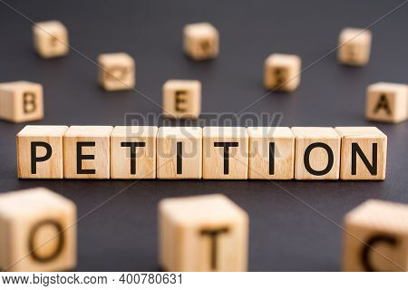 Petition - Word From Wooden Blocks With Letters, A Formal Request Petition Concept, Random Letters A