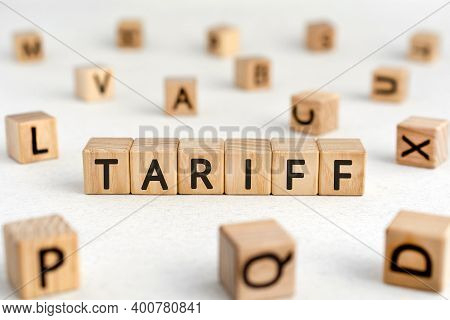 Tariff - Words From Wooden Blocks With Letters, A Tax On Imports Or Exports Tariff Concept, White Ba