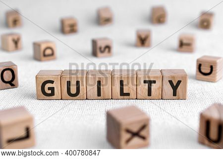 Guilty - Words From Wooden Blocks With Letters, Culpable Guilty Concept, White Background