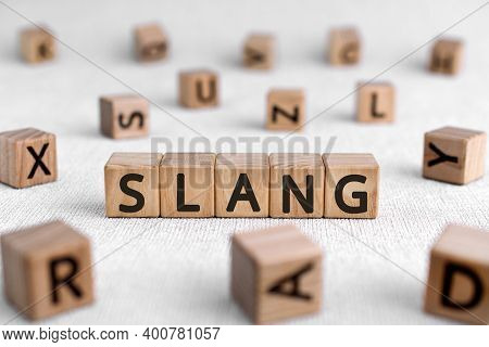 Slang - Words From Wooden Blocks With Letters, A Type Of Language Slang Concept, White Background