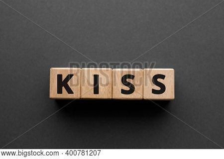 Kiss - Words From Wooden Blocks With Letters, Keep It Simple, Stupid Kiss  Concept, Top View Gray Ba