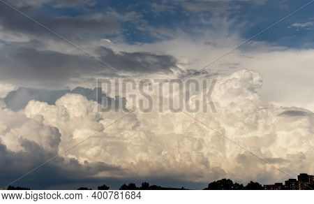 Big Fluffy Clouds On The Blue Sky. Autumn Sky With White Curly Clouds