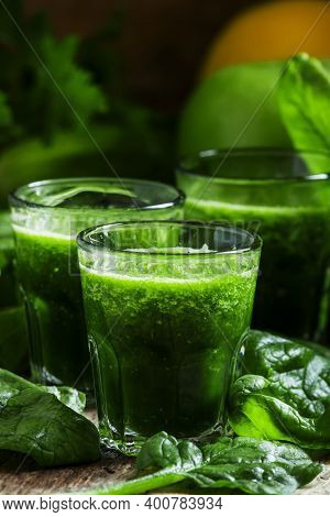 Green Juice Of Spinach, Apples And Lemon, Small Glasses, Selective Focus