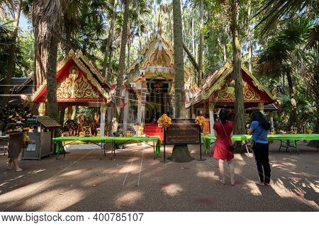 Udon Thani, Thailand-december 22, 2020: Asian Female Traveler Visit And Respect Praying Holy Thing I