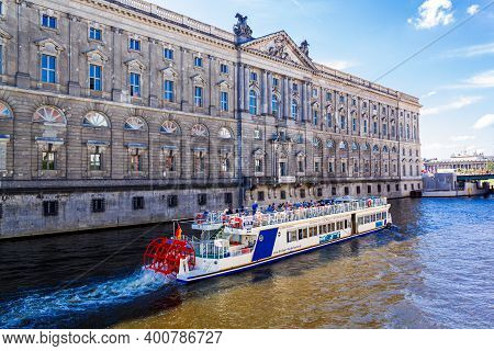 Berlin, Germany - 22 August 2011: A Tourist Ship Sails Down The Spree River On The Background Of The