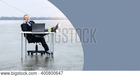 Elderly Gray-bearded Businessman In Suit, Smiling While Talking On Smartphone, Threw His Legs In Hoc