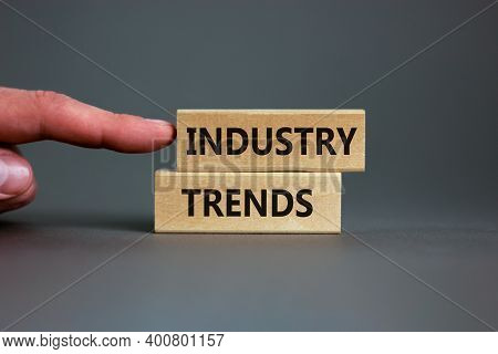 Industry Trends Symbol. Wooden Blocks With Words 'industry Trends' On Beautiful Grey Background. Mal