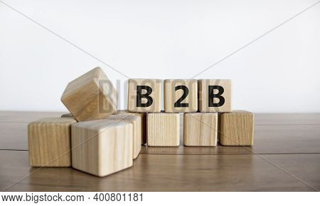 B2b Symbol. Concept Word 'b2b - Business To Business' On Cubes On A Beautiful Wooden Table, White Ba