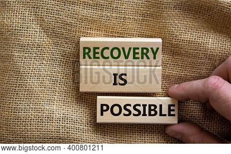 Recovery Is Possible Symbol. Wooden Blocks With Words 'recovery Is Possible'. Beautiful Canvas Backg