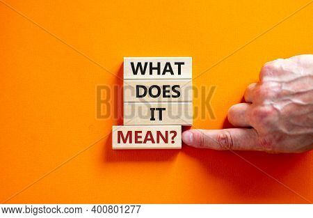 What Does It Mean Symbol. Wooden Blocks With Words 'what Does It Mean'. Beautiful Orange Background,
