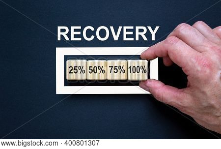 Recovery Symbol. Loading Percentages With Hand Putting Wood Cube In Progress Bar. Word 'recovery'. B