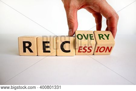 Recession Or Recovery Symbol. Hand Turns Cubes And Changes The Word 'recession' To 'recovery'. Beaut