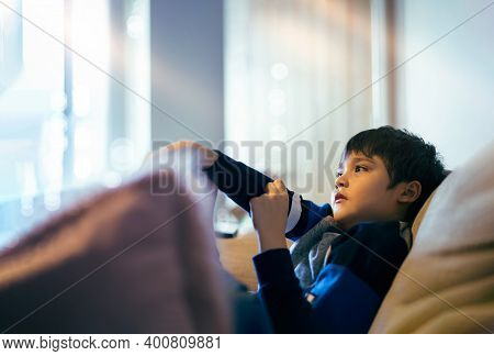 Cinematic Portrait Young Boy Siting On Sofa Watching Tv, Candid Shot Kid Siting Alone On Couch Looki
