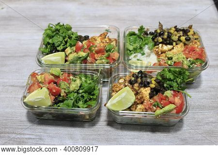 Meal Prep In Glass Lunch Boxes Of Burrito Bowls