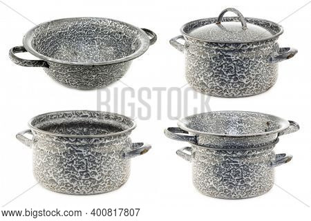 vintage  empty grey enamel cooking pans and a colander on a white background