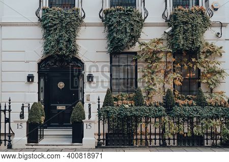 London, Uk - December 5, 2020: Facade Of Greenery Covered Traditional House In Mayfair, An Affluent