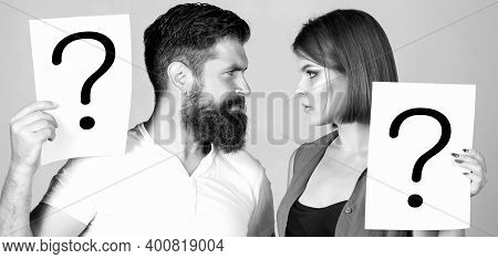 Confused Couples With Question Marks. Conflict Between Two People. Pensive Man And A Thoughtful Woma
