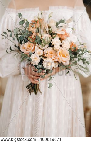 Wedding Bouquet With Peonies In The Hands Of The Bride Under The Veil.morning Of The Bride