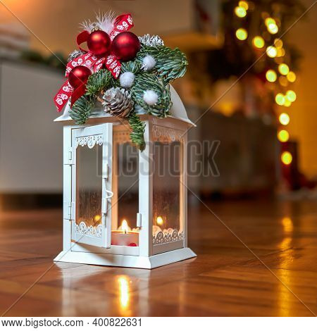 Christmas White Lantern Decorated With New Years Toys. Christmas Candlestick On A Wooden Background