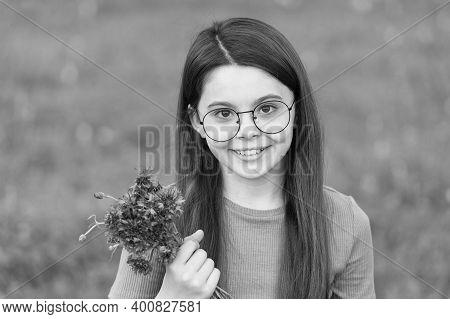 Love Your Skin Naturally. Happy Girl Hold Flowers Outdoors. Natural And Organic Skincare. Baby Skin
