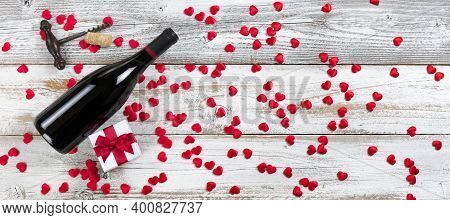 Full Bottle Of Red Wine Plus Giftbox With Little Red Lovely Hearts On White Rustic Natural Wood In F