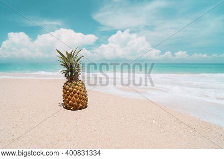 Pineapple On Tropical Beach Background. Summer Vacation And Healthy Food Concept. Vintage Tone Filte