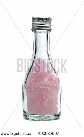 Pink Rock Sugar Or Crystalline Sugar Glass Bottle Isolated On White Background