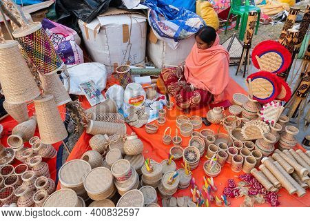 Kolkata, West Bengal, India - 31st December 2018 : Young Bengali Woman Making Wicker Baskets , Handi