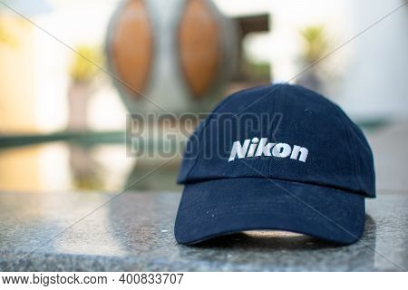 Dark Blue Trendy Cap With Trade Mark Nikon Isolated On A Blurred Background. Sporty Style. Kolkata,