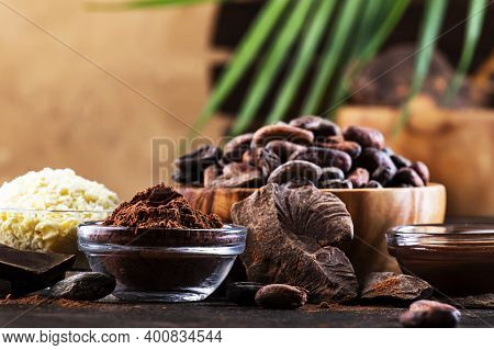 Various Organic Cocoa Products. Cocoa Beans, Cocoa Powder, Cocoa Butter, Dark Chocolate, Liquid Choc