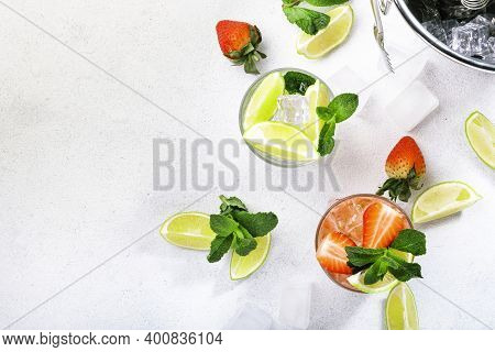 Fresh Mojito Cocktail Set With Lime, Mint, Strawberry And Ice In Glass On White Background. Summer C