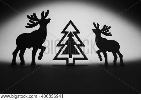 Horizontal Conceptual Photo Of A Black Silhouettes Of Two Deers, Celebrating Merry Christmas Aorund