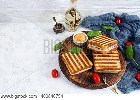 Club Sandwich With Ham, Tomato, Cheese And Spinach. Grilled Panini
