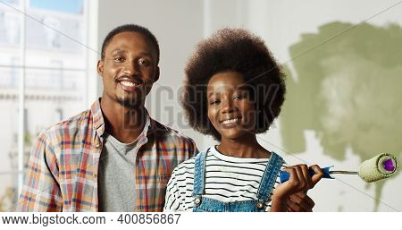 Close Up Portrait Of Joyful African American Family Couple Wife And Husband Stand In Room During Hom