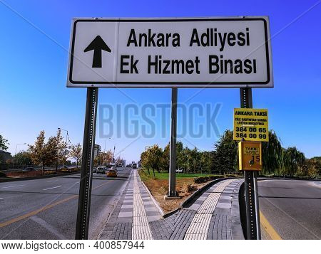 Turkey, Ankara - October 24, 2019: White Road Sign With Arrow And Yellow Box With Taxi Call Button O