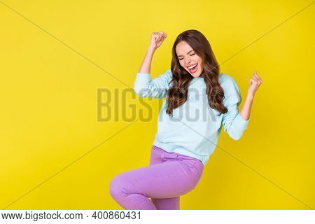 Photo Of Adorable Energetic Young Girl Eyes Close Raise Fists Knee Ecstatic Pose Open Mouth Win Cine