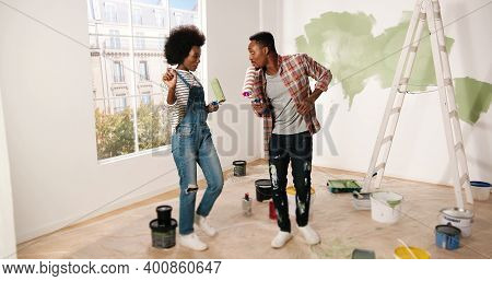 Young Cheerful African American Couple Man And Woman Hugging And Embracing In Good Mood Smiling In A