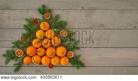 Top View Of A Christmas Tree Made From Fresh Oranges And Dried Orange Chips, Branches Of A Christmas
