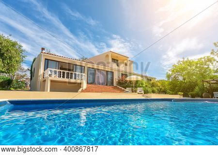 A Luxury Pool With Clear Blue Water Overlooking The Garden Villa. For Rent To Tourists.