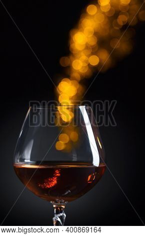 Snifter Of Brandy With Space For Text. Black Background.