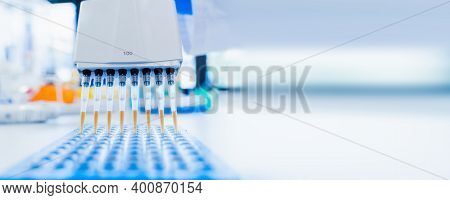 Medical And Scientific Banner With Free Space. 8-channel Pipette And 96-well Test Plate. Genetic Lab