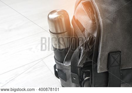 Preparing For Hiking Adventure. Outing Into Nature Concept. Background With Backpack And Thermos Sta