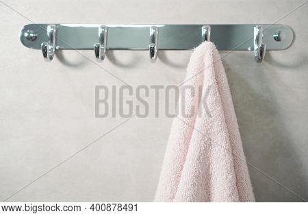 Towel Hanging On A Wall In A Bathroom