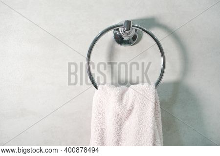 A Round Towel Ring On The Porcelain Stoneware Wall. Hand Towel Background.